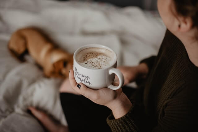 woman-drinking-morning-coffee-with-her-pet