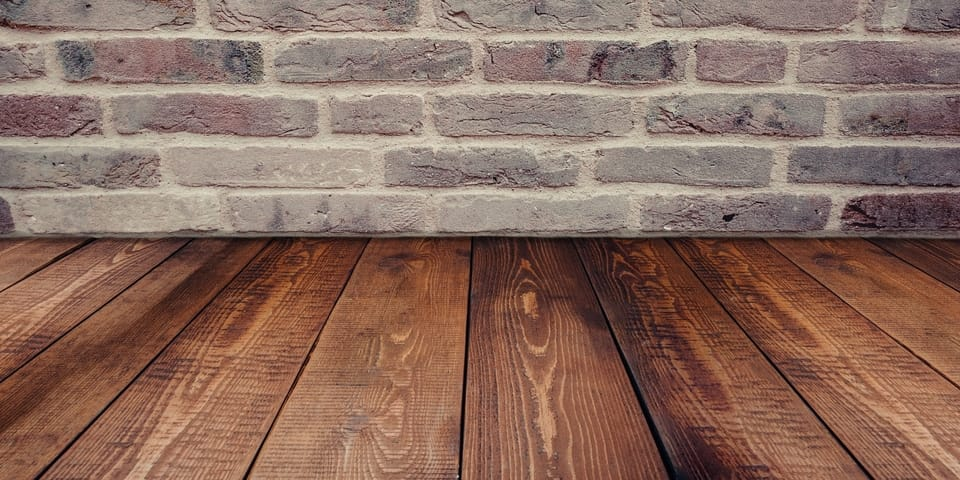 wood-floor-brick-wall